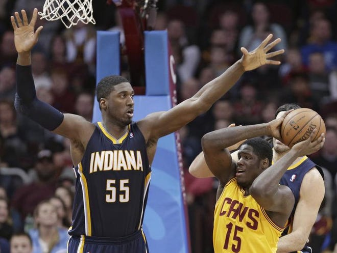 Cleveland Cavaliers' Anthony Bennett (15) looks for help under pressure from Indiana Pacers center Roy Hibbert (55) during the fourth quarter on Sunday. The Pacers defeated the Cavaliers, 82-78.