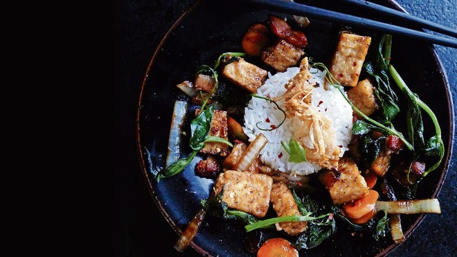 A stir-fry of pea shoots, carrot and salad turnip.