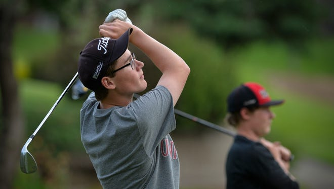 Albany High School senior David Schneider watches a drive while practicing Wednesday, May 25, 2016, on the range with the team at the Albany Golf Club. Schneider is the Times All-Area Boys Golf Player of the Year.