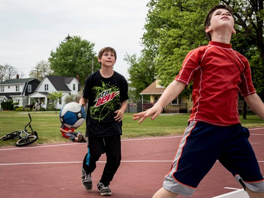 Steven Eagle, 14, goes for a shot while playing basketball with Andrew Kolinsky, 12, both of Port Huron, Friday, May 27, 2016 at Lincoln Park in Port Huron.