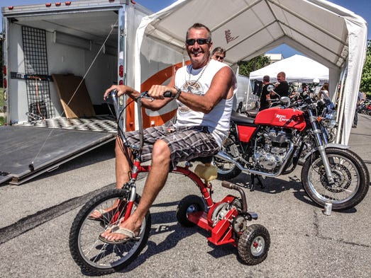 Saturday May 31st, Kevin Martyn sits atop his 80cc, prototype, Radical Flyer. Vintage riders gathered across from the Melody Inn, for the conclusion of the Rolling Bones  3, Vintage Motorcycle Run, and  tun Up Indy's, Rocker's Reunion 2014, Vintage Motorcycle Show, benefitting Riley Hospital For Children.