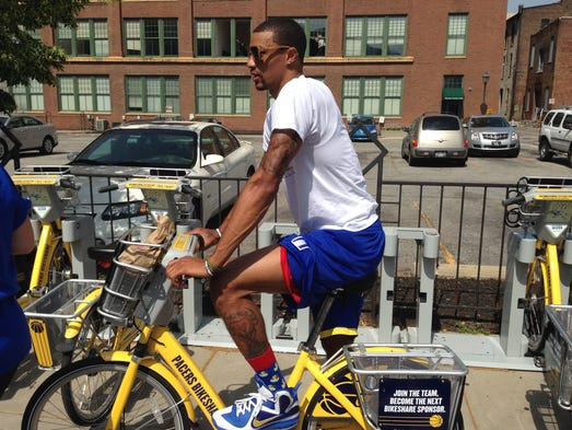 The Indiana Pacers' George Hill waits for the Pacers Bikeshare ride to begin on Wednesday, June 18. The Bikeshare program was free for the day with a promotional code.