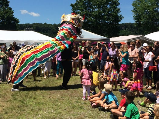 Performers entertain children and adults and celebrate Chinese culture at the Dragon Boat Race and Festival Saturday.