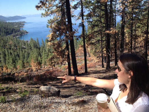 Amy Berry of the Tahoe Fund shows where a proposed new path could make it safer and easier to get from Incline Village to Sand Harbor State Park along Lake Tahoe.