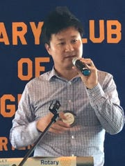 Alupang Residence President Tae S. Oh addresses the Rotary Club of Guam on Thursday, Aug. 10.