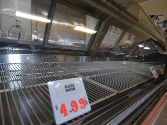 The shelves of Newswanger Meats are empty Tuesday morning after an area of the facility tested positive for bacteria.