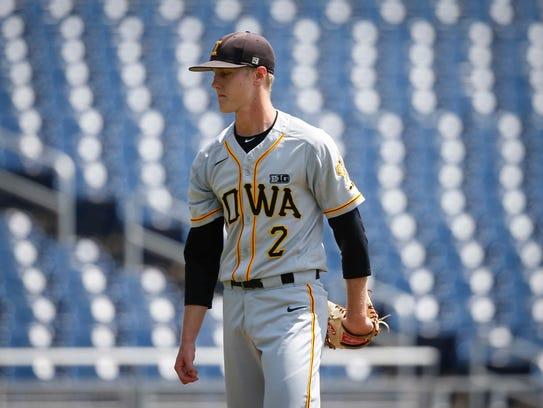 Iowa junior pitcher Zach Daniels heads off the mound