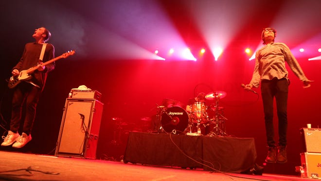 Joywave was one of four bands playing at the Main Street Armory  concert put on by radio station The Zone's 94.1 Rover's Holiday Hangover 2016.  Leaping in the air are bass guitarist Sean Donnelly and singer Daniel Armbruster.