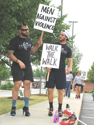"Cody Ringle and Ian Burkhart of Fortitude Strength raised money and awareness of the problem of domestic and sexual violence during ""Walk-A-Mile in their Shoes"" on Saturday."
