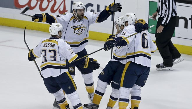 Nashville Predators center Paul Gaustad (28) celebrates with teammates after scoring during the first period of Game 7 in the first round on  April 27, 2016.