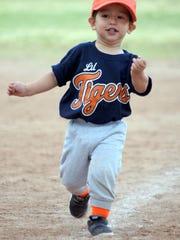 Two-year-old Li'l Tigers slugger Eli Ramirez listens