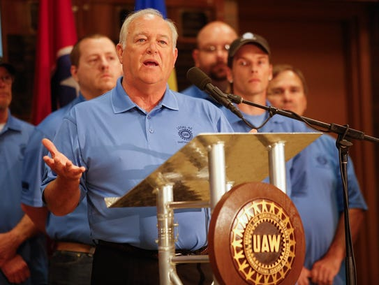 UAW President Dennis Williams speaks during a news