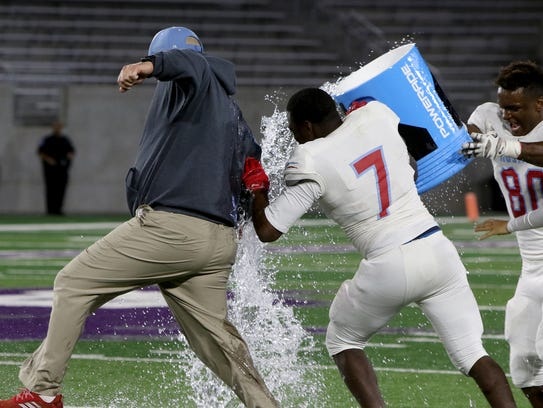 Hirschi's Isaiah White (7) and Amiri Campbell (80)