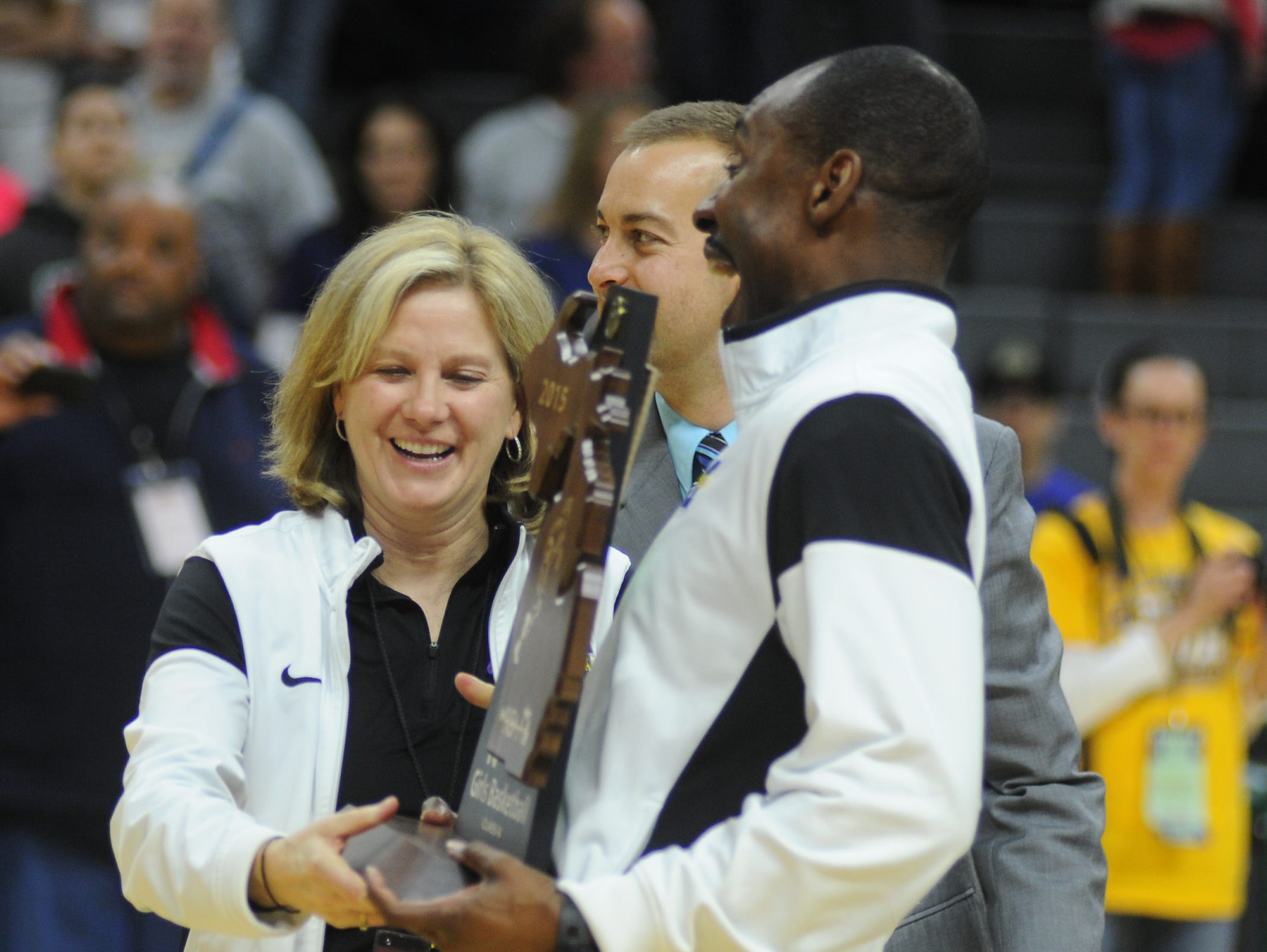 Head coach Mary Cicerone and assistant Derek Thomas were all smiles after leading Marian to back-to-back Class A state championships for the first time in program history. Thomas will not be on staff next season.