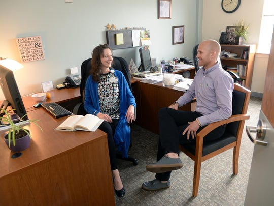 Behavioral health social workers Patti Sabla of Vineland and Joe O'Brien of Pittman talk in her office at Inspira Health Center Bridgeton, Wednesday, Jun. 3, 2015 in Bridgeton. Staff Photo/Sean M. Fitzgerald