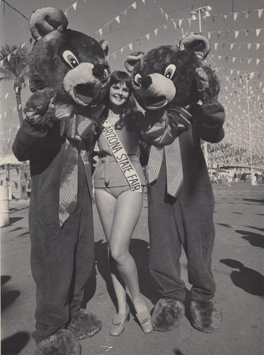 Miss Arizona State Fair posses with two bears at the Arizona State Fair on October 31, 1969.