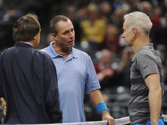 Lendl and McEnroe meet to talk before the start of the match. John McEnroe defeated Ivan Lendl in a PowerShares Tennis match at Bankers Life Fieldhouse Friday February 14, 2014.
