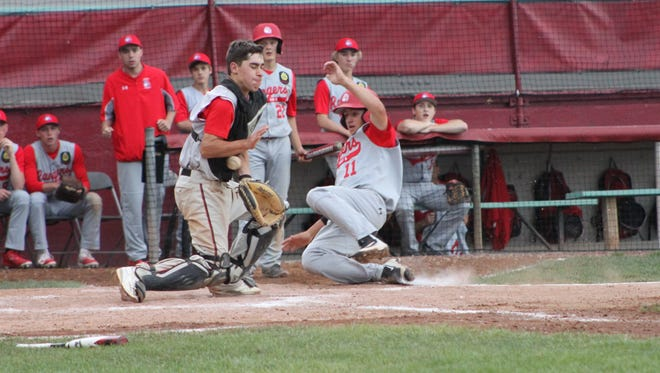 Cody Bredl (11) slides into home during the Rangers tournament matchup against Altoona on Saturday.