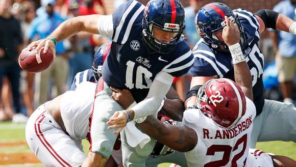Mississippi quarterback Chad Kelly (10) breaks away