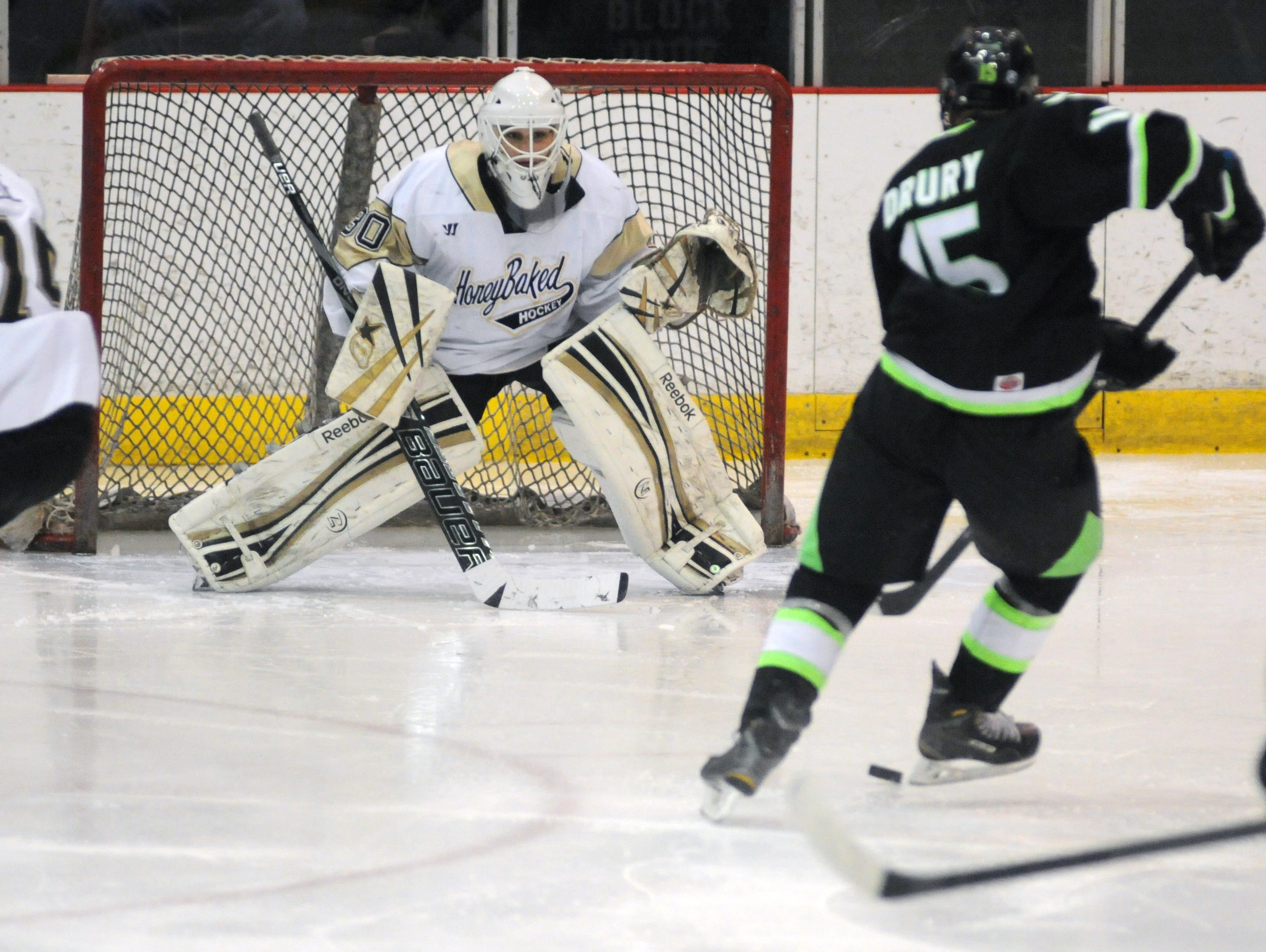 Honeybaked goaltender, Christian Stoever eyes the puck Sunday, Jan 11 during the Bantam AAA Silver Stick Finals championship game.