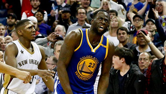 Draymond Green reacts after stealing the ball from Pelicans forward Anthony Davis during the fourth quarter.