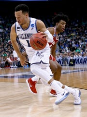 Villanova's Jalen Brunson (1) drives past Alabama's Collin Sexton during the second half of a second-round game in the NCAA men's college basketball tournament, Saturday, March 17, 2018, in Pittsburgh. Alabama won 81-58. (AP Photo/Keith Srakocic)