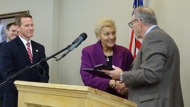 Beverly Gray accepts the 2016 Ohio Statehood Day Achievement Award from Rick Marriott, of the Chillicothe Kiwanis Club.