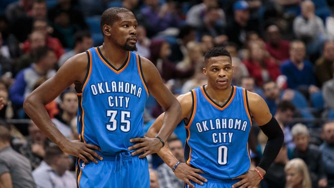 Kevin Durant and Russell Westbrook in the third quarter against the Minnesota Timberwolves at Target Center.