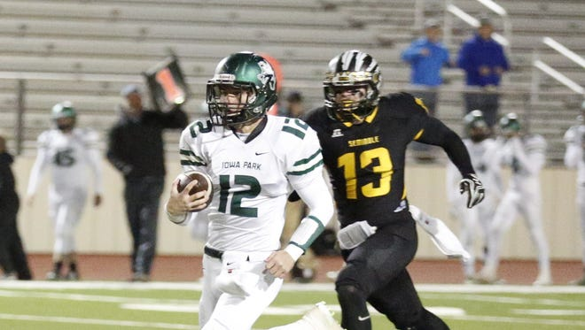Iowa Park quarterbck Colton Dickerson (12) breaks away on a 66-yard touchdown run in the first quarter of Friday's Region I-4A area playoff game at Peoples Bank Stadium in Wolfforth.