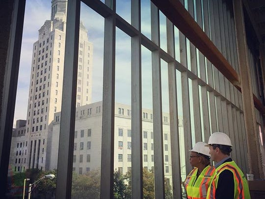 Camden Mayor Dana Redd and U.S. Rep. Donald Norcross look at City Hall and Roosevelt Park from the new Rutgers Nursing and Sciences building in 2016.