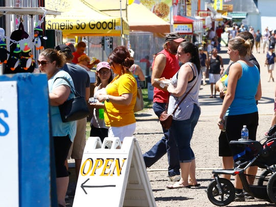People inline to order food Friday at the Lincoln County Fair in Merrill.