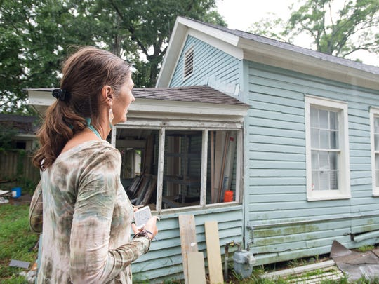 Prospective homeowner Rachel Mahone checks out the home at 1211 E. Cervantes St. in Pensacola during an open house Tuesday.