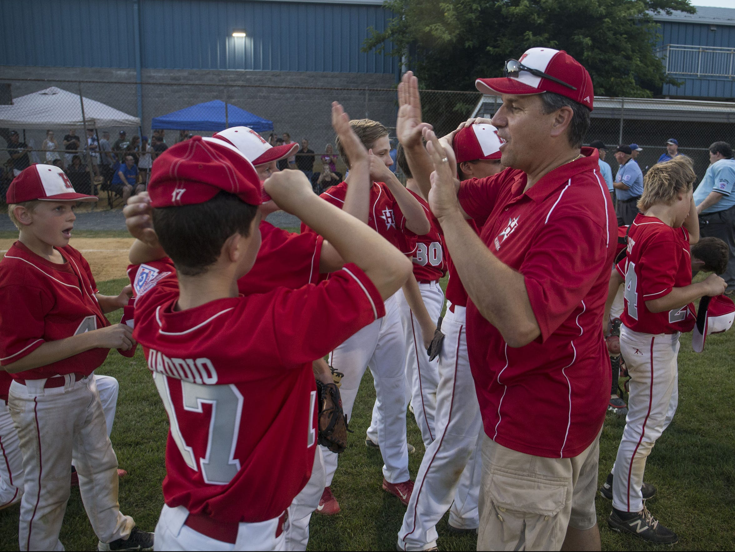 The Holbrook Little League All-Stars celebrate their