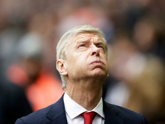 "FILE - In this Saturday, Feb. 10, 2018 file photo, Arsenal's manager Arsene Wenger looks on before their English Premier League soccer match against Tottenham Hotspur at Wembley Stadium, London. Irked that his future is again under scrutiny, Arsenal manager Arsene Wenger reminded his critics he ""turned the whole world down"" to stay at the club and refused to comment on an end-of-season review regarding his position. (AP Photo/Tim Ireland, file)"