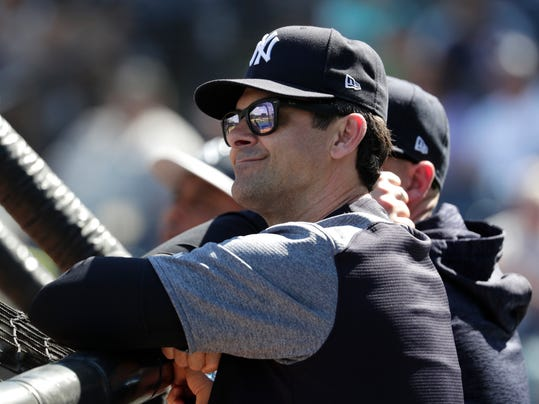FILE - In this Feb. 19, 2018, file photo, New York Yankees manager Aaron Boone watches batting practice at spring training in Tampa, Fla. New York fired Joe Girardi, its manager for a decade, and brought in ESPN analyst Boone. Remembered in New York for his pennant-winning home run off Boston's Tim Wakefield in Game 7 of the 2003 ALCS, Boone had never managed or coached at any level. (AP Photo/Lynne Sladky, File)