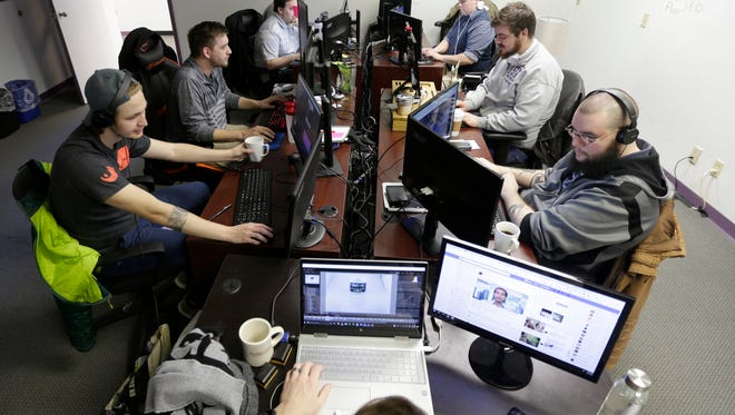 Margle Media employees edit videos in the production studio Wednesday.