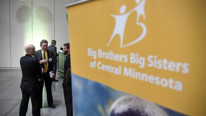 """People gather Friday, April 7, at the start of the Big Brothers Big Sisters of Central Minnesota Magic Moments Gala at the River's Edge Convention Center in St. Cloud. The theme for this year's event was """"From Little Seeds Grow Mighty Trees."""""""
