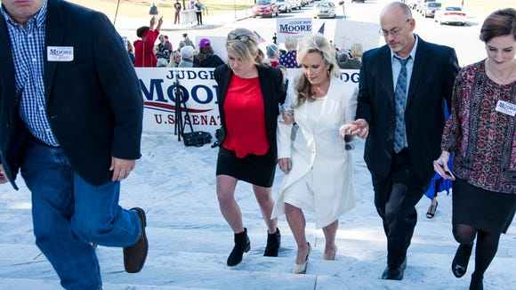 Kayla Moore, wife of Republican Senate nominee Roy Moore, walks away after speaking about the character of Roy Moore at a press conference on Friday, Nov. 17, 2017, in Montgomery, Ala.