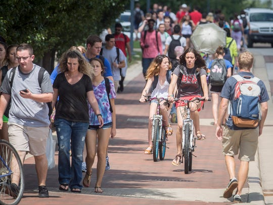 Students travel along McKinley Ave. Tuesday afternoon on Ball State University's campus. This year's freshman class of 3,911 students is the third-largest of all time.