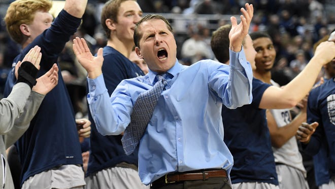 Nevada head coach Eric Musselman cheers on his team during a win over Boise State this season.
