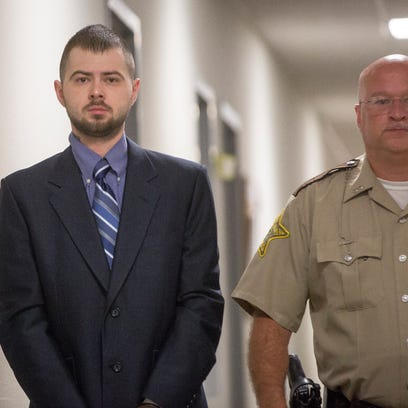 Cory Wallace is led to Delaware County Circuit Court