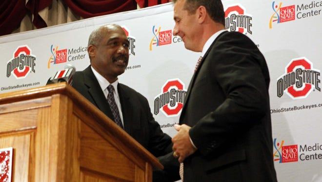 Ohio State athletic director Gene Smith, left, and OSU football coach Urban Meyer.