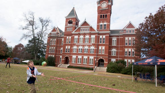 Hayes Kenerly catches a football in front of Samford