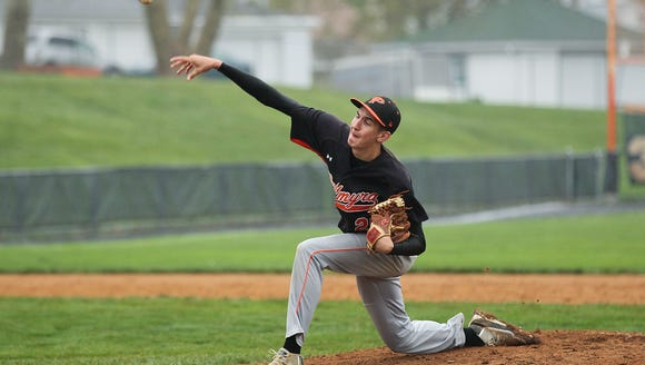 Palmyra junior Isaac Blatt pitches during his complete