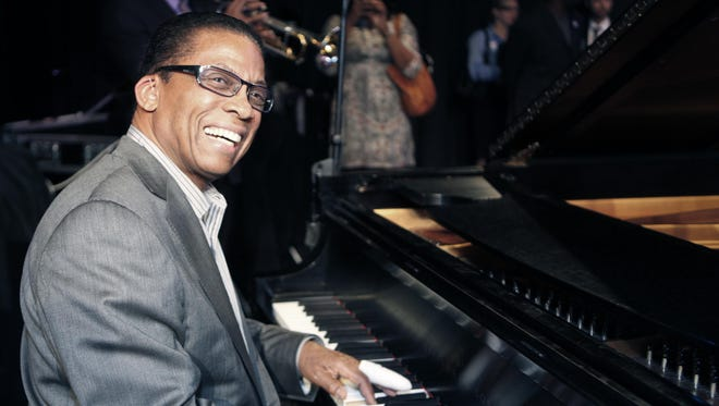 Jazz legend Herbie Hancock sits at a piano in 2011.