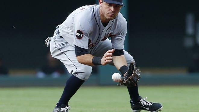 Tigers second baseman Ian Kinsler fields a ground ball.