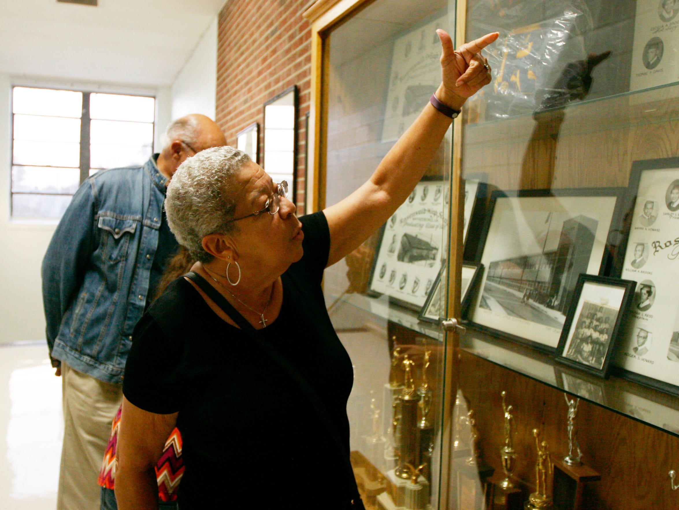Charlotte Redd Wood looks at old photos from Rosenwald