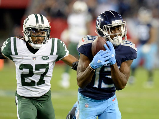 Tennessee Titans wide receiver Taywan Taylor (13) catches a pass in front of New York Jets cornerback Darryl Roberts (27) in the second half of an NFL football game Sunday, Dec. 2, 2018, in Nashville, Tenn. (AP Photo/Mark Zaleski)
