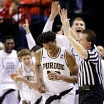 The Purdue Boilermakers bench reacts as forward Caleb Swanigan (50) drains a three-pointer against the Illinois Fighting Illini at Bankers Life Fieldhouse in Indianapolis on March 11, 2016.