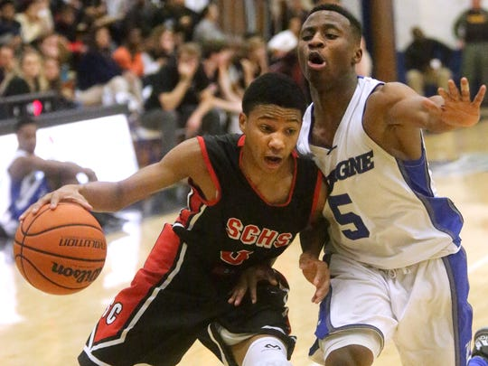 Stewarts Creek's Desmond Sales (3) pushes toward the basket s he is guarded by La Vergne's Glenn Roberts (5). Creek, the fourth seed from District 7-AAA, plays at Lawrence County on Saturday. Lawrence County was the top seed from District 8-AAA.